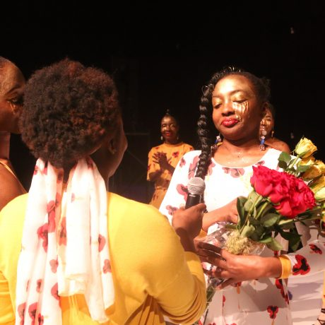 Owner/ Designer De'Andria receives flowers from sisters Bria (GT Choreagrapher) and Jazma (Event Organizer/Planner)